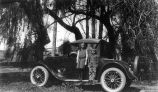 Kids and new car, (c. 1935), photograph