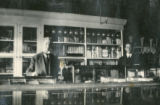 Photograph of early Banning, California merchants, Jack Lowenthal and Mr. Clark in their store