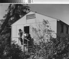 Photograph of a family outside a unit at Keppler Grove