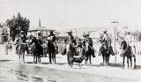 Mexican musicians on horseback.