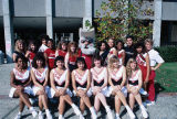 Slide of the cheerleaders of CSUH with the mascot, Pioneer Pete