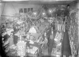 Upland Photograph Business; Interior view of the E.H. Haury & Co. Dry Goods and Variety Store decorated for Christmas, staff and customers are in this photograph / Edna Swan