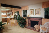 [Madrid Homes, plan 610 model home kitchen and fireplace slide].