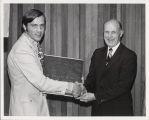 Plaque presentation to Dr. Wallace W. Hall by Santa Clara city councilman, Gary Hansen
