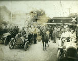 Automobiles rally at the railroad crossing, circa 1912.