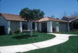 [New Castille Homes, plan 10 model home exterior slide].