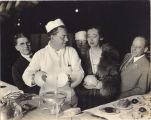 Actress Helen Jerome Eddy Watching a Chef Crack an Ostrich Egg