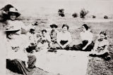 Salinan family picnic at Morro Bay : circa 1916 ; Maria Antonia Pierce (nee Baylon), at viewer's left holding pie.