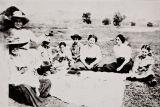 Salinan family picnic at Morro Bay : circa 1916 ; Maria Antonia Pierce (nee Baylon), at viewer's left holding pie.