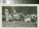 Leslie C. Brand sitting with friends and family at the lodge