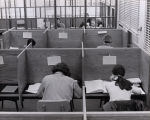 A photograph of students enjoying the privacy of the study carrels.