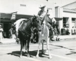 Two men on horses during parade along North San Gorgonio Avenue in Banning, California