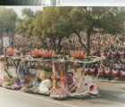 """[""""The Water Babies"""" 1979 Rose Parade float from Mission Viejo photograph]."""