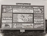 Lou P. Hickox photograph of advertising billboards pertaining to merchants in Santa Ana