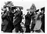[Bankers and briefcases at St. Patrick's Day parade, 1981 photograph].