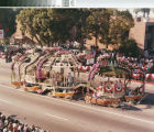 "[""Sunday at the Lake"" 1985 Rose Parade float from Mission Viejo photograph]."