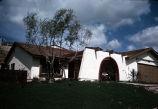 [La Paz model home exterior, San Carlos slide].