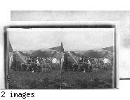 Feeding the dogs at Hopedale, Eskimo Village, Labrador.