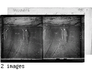 Group of miners in the main tunnel (1 1/2 mile long) of a huge coal mine.