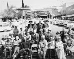 Pass Pioneers group on platform in front of First Street in Banning, California