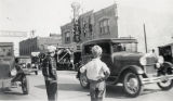 Two boys and automobiles on Ramsey Street in Banning, California during the Colorado River Aqueduct celebration