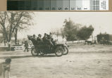 A group of men drive past the cemetery in a REO car in Turlock, California, circa 1907.