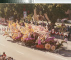 "[""Springtime Magic"" 1984 Rose Parade float from Mission Viejo photograph]."