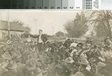 An unidentified man promotes the benefits of buying land near Turlock, California, circa 1907.