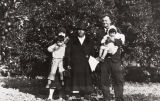 John P. Harrington and two of his principal Barbareno Chumash consultants at the site of their former adobe home, Indian Orchard, Goleta : 1931 ; left to right: Mary J. Yee (nee Rowe), holding her son John Yee, Lucrecia Garcia (nee Ygnacio), John Harrington holding Angela Yee.