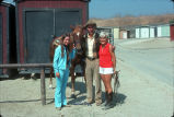 [Philip J. Reilly, two women and a horse at Mission Viejo Equestrian Center, 1975 slide].