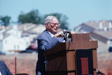 An unknown man speaking at the groundbreaking of the Contra Costa Campus