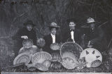 Four individuals with baskets purchased on the Morongo Indian Reservation