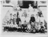 Photograph of classroom of children and teacher